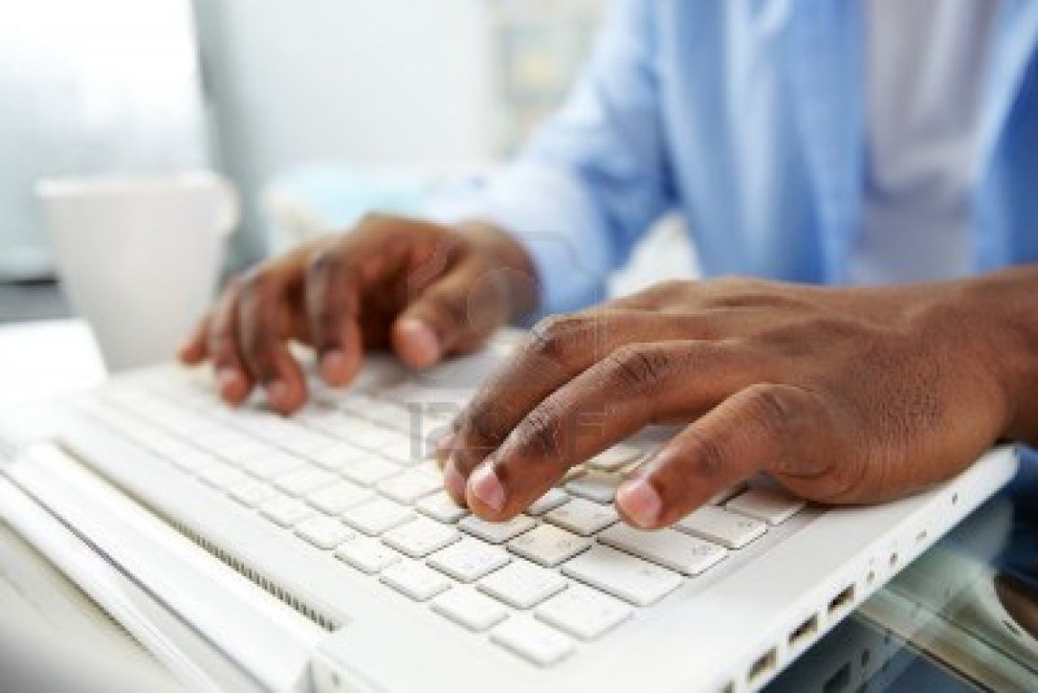 13949199-close-up-of-african-man-typing-on-laptop