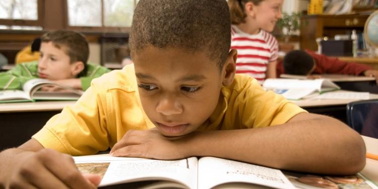 o-BLACK-STUDENT-READING-facebook