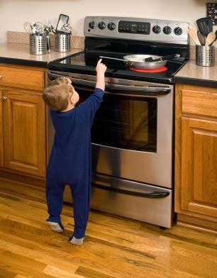 149114-306x392-Toddler-reaching-for-hot-pan.jpg